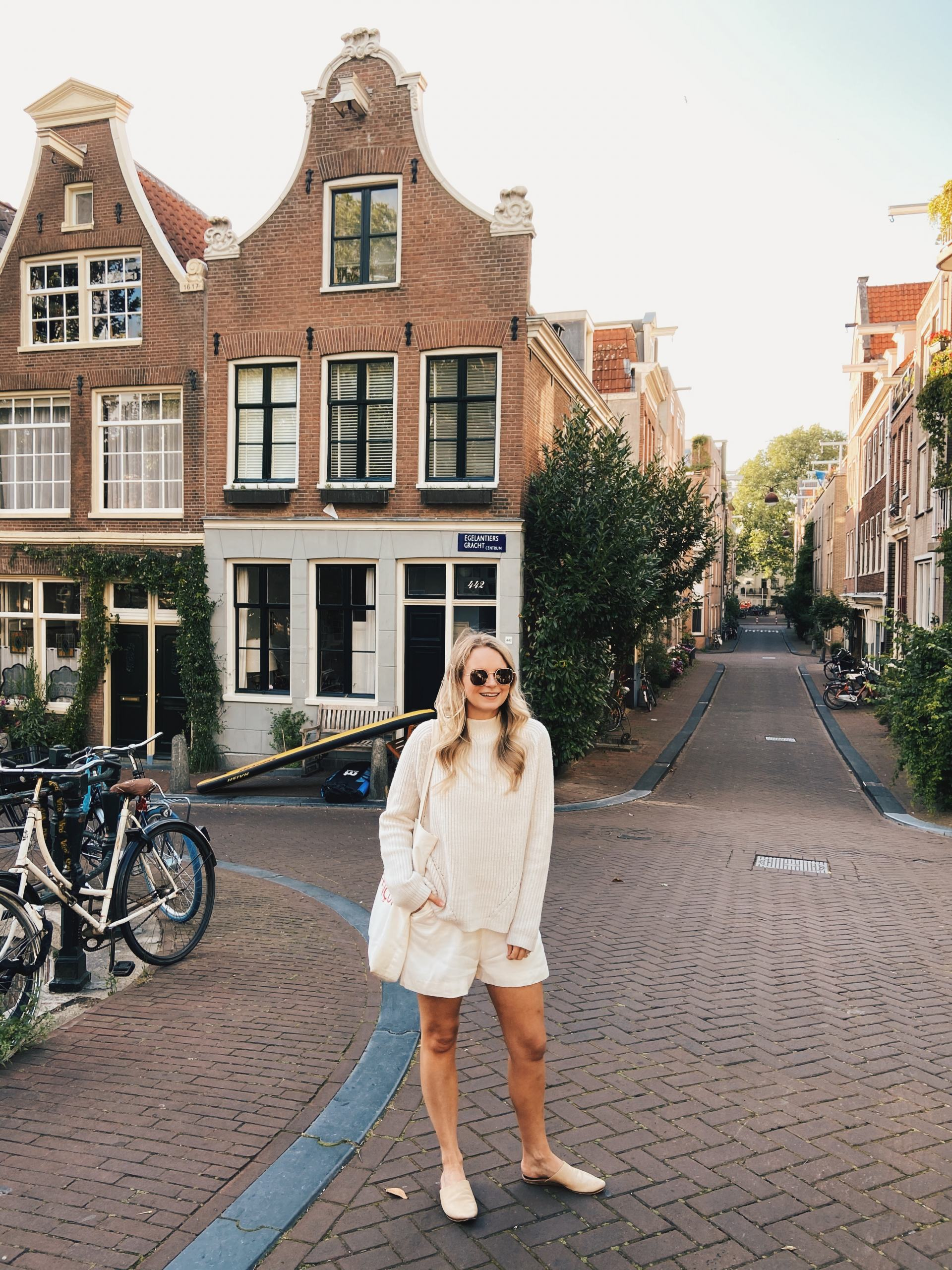 blonde in all white outfit in amsterdam